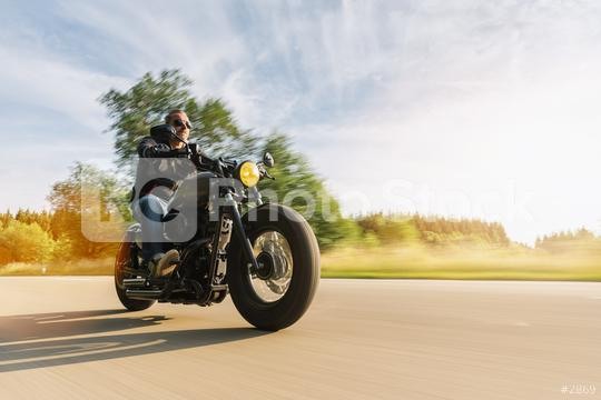 High power motorbike chopper on the country road riding at summer. having fun driving the empty road on a motorcycle tour. copyspace for your individual text.  : Stock Photo or Stock Video Download rcfotostock photos, images and assets rcfotostock | RC-Photo-Stock.: