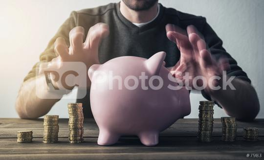 hipster hand taking care of piggy bank  : Stock Photo or Stock Video Download rcfotostock photos, images and assets rcfotostock   RC-Photo-Stock.: