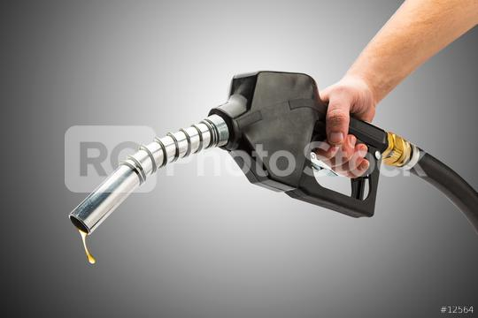holding a gas pump nozzle  : Stock Photo or Stock Video Download rcfotostock photos, images and assets rcfotostock | RC-Photo-Stock.: