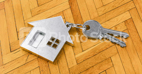 House as a pendant on a key on wooden floor as a house purchase and housing concept  : Stock Photo or Stock Video Download rcfotostock photos, images and assets rcfotostock | RC-Photo-Stock.: