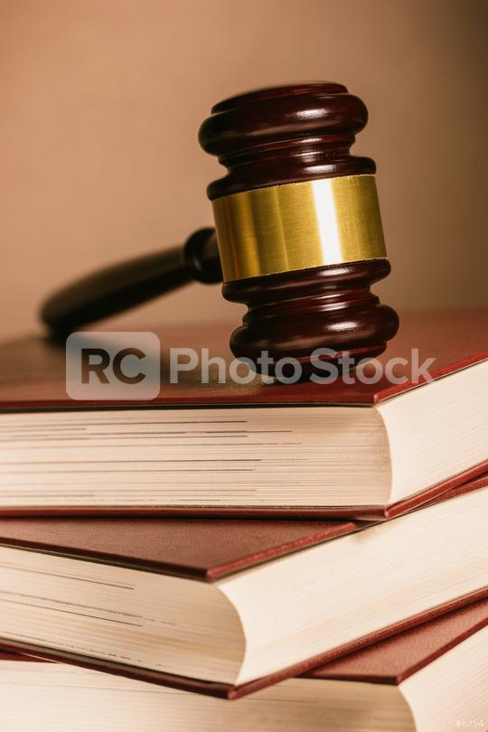 judge gavel lies on stacked Books  : Stock Photo or Stock Video Download rcfotostock photos, images and assets rcfotostock | RC-Photo-Stock.: