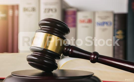 judge gavel on a open law book with germany law books in the background in a lawyer office   : Stock Photo or Stock Video Download rcfotostock photos, images and assets rcfotostock | RC-Photo-Stock.: