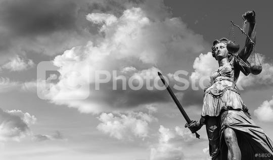 Lady Justice with cloudy sky black and white  : Stock Photo or Stock Video Download rcfotostock photos, images and assets rcfotostock | RC-Photo-Stock.:
