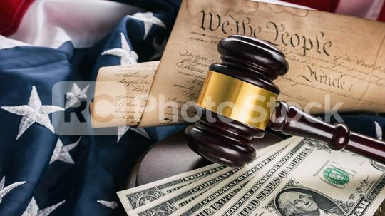 law gavel with money on the usa flag with American Constitution  : Stock Photo or Stock Video Download rcfotostock photos, images and assets rcfotostock   RC-Photo-Stock.:
