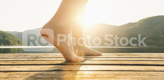 Legs on jetty from a young woman at sunset. yoga concept image  : Stock Photo or Stock Video Download rcfotostock photos, images and assets rcfotostock   RC-Photo-Stock.: