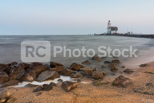 lighthouse at a stony beach  : Stock Photo or Stock Video Download rcfotostock photos, images and assets rcfotostock   RC-Photo-Stock.: