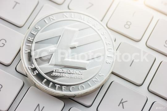 Litecoin cryptocurrency, digital money on a keyboard  : Stock Photo or Stock Video Download rcfotostock photos, images and assets rcfotostock | RC-Photo-Stock.: