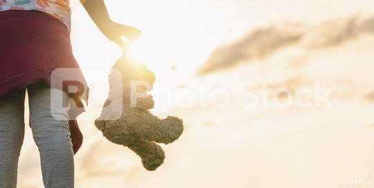 lonley girl holding a teddy bear at sunset. copyspace for your individual text.  : Stock Photo or Stock Video Download rcfotostock photos, images and assets rcfotostock | RC-Photo-Stock.: