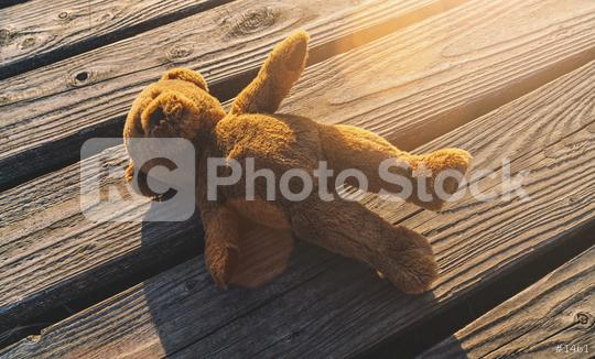 Lost teddy bear lying on a boardwalk  : Stock Photo or Stock Video Download rcfotostock photos, images and assets rcfotostock | RC-Photo-Stock.: