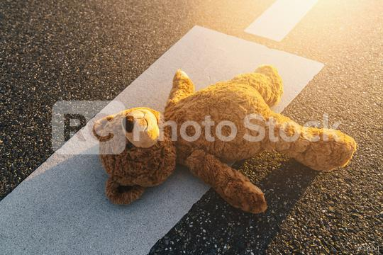 Lost teddy bear lying on the street after an accident  : Stock Photo or Stock Video Download rcfotostock photos, images and assets rcfotostock   RC-Photo-Stock.: