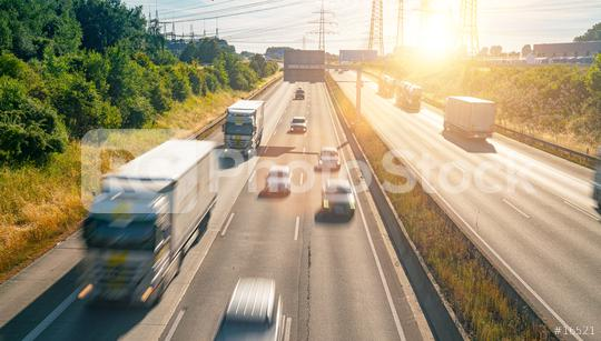 Lots of Trucks and cars on a Highway - transportation concept  : Stock Photo or Stock Video Download rcfotostock photos, images and assets rcfotostock   RC-Photo-Stock.: