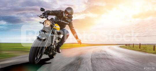 man on a motorbike on the road riding. having fun driving the empty road on a motorcycle tour journey. copyspace for your individual text.  : Stock Photo or Stock Video Download rcfotostock photos, images and assets rcfotostock | RC-Photo-Stock.: