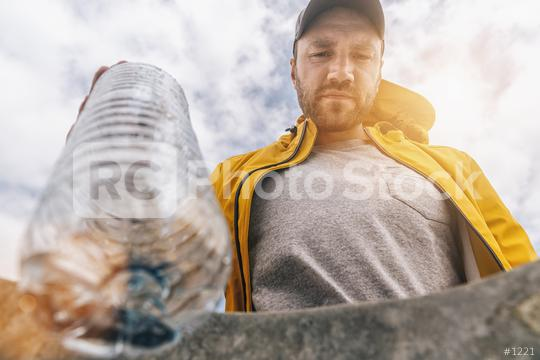 man throw plastic bottle in to garbage  : Stock Photo or Stock Video Download rcfotostock photos, images and assets rcfotostock | RC-Photo-Stock.: