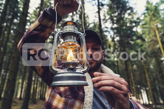 Man using a Gasoline lamp in the deep forest at autumn  : Stock Photo or Stock Video Download rcfotostock photos, images and assets rcfotostock   RC-Photo-Stock.:
