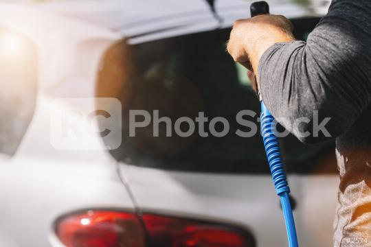 Man worker washing car on a car wash  : Stock Photo or Stock Video Download rcfotostock photos, images and assets rcfotostock | RC-Photo-Stock.: