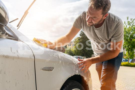Man worker washing car with sponge  : Stock Photo or Stock Video Download rcfotostock photos, images and assets rcfotostock | RC-Photo-Stock.: