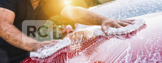 Man worker washing red sports car with sponge on a car wash.  : Stock Photo or Stock Video Download rcfotostock photos, images and assets rcfotostock | RC-Photo-Stock.:
