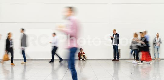 Many anonymous blurry people go in the airport or at a trade fair  : Stock Photo or Stock Video Download rcfotostock photos, images and assets rcfotostock | RC-Photo-Stock.:
