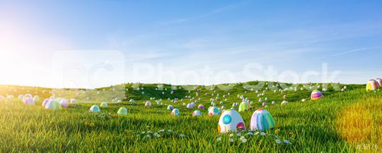 Many colorful easter eggs painted with water paint in the grass of a meadow for easter  : Stock Photo or Stock Video Download rcfotostock photos, images and assets rcfotostock | RC-Photo-Stock.: