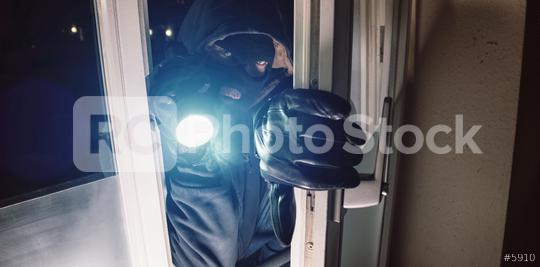 Masked burglar entering amd breaking into a house window with  flashlight   : Stock Photo or Stock Video Download rcfotostock photos, images and assets rcfotostock | RC-Photo-Stock.: