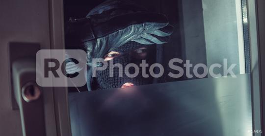masked Burglar looks into a house windows at night  : Stock Photo or Stock Video Download rcfotostock photos, images and assets rcfotostock | RC-Photo-Stock.: