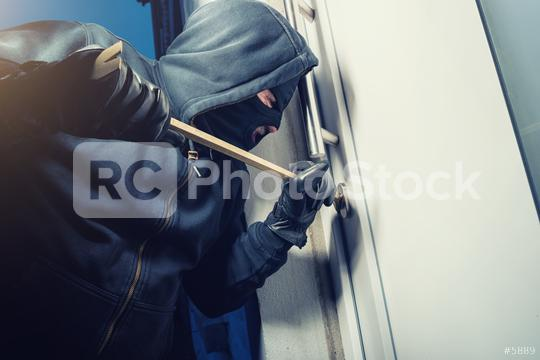 masked burglar opens a door with a crowbar  : Stock Photo or Stock Video Download rcfotostock photos, images and assets rcfotostock | RC-Photo-Stock.: