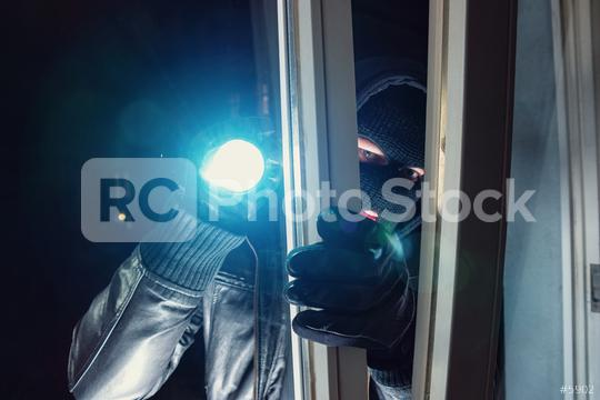 Masked Burglar shines with flashlight in to a Victim´s home at night  : Stock Photo or Stock Video Download rcfotostock photos, images and assets rcfotostock | RC-Photo-Stock.:
