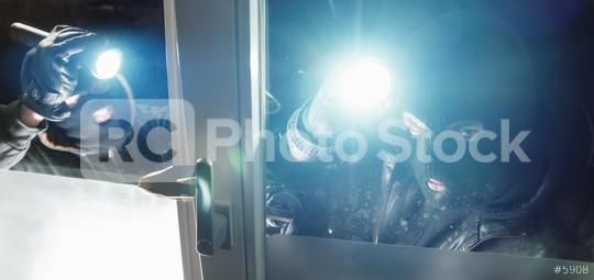 masked Burglar team with crowbar and flashlight breaking into a house windows  : Stock Photo or Stock Video Download rcfotostock photos, images and assets rcfotostock | RC-Photo-Stock.:
