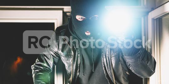 Masked burglar with crowbar breaking and entering into a house - shot with dramatic motion  : Stock Photo or Stock Video Download rcfotostock photos, images and assets rcfotostock | RC-Photo-Stock.: