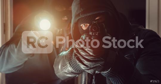 masked Burglar with gun and flashlight breaking into a house   : Stock Photo or Stock Video Download rcfotostock photos, images and assets rcfotostock | RC-Photo-Stock.:
