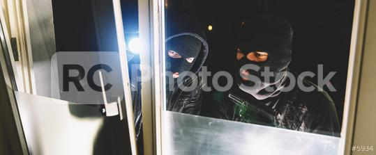 Masked man as a burglar or thief with flashlight and balaclava  : Stock Photo or Stock Video Download rcfotostock photos, images and assets rcfotostock | RC-Photo-Stock.: