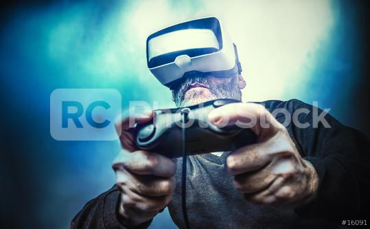 Mature man wearing virtual reality goggles / VR Glasses to play video games  : Stock Photo or Stock Video Download rcfotostock photos, images and assets rcfotostock | RC-Photo-Stock.: