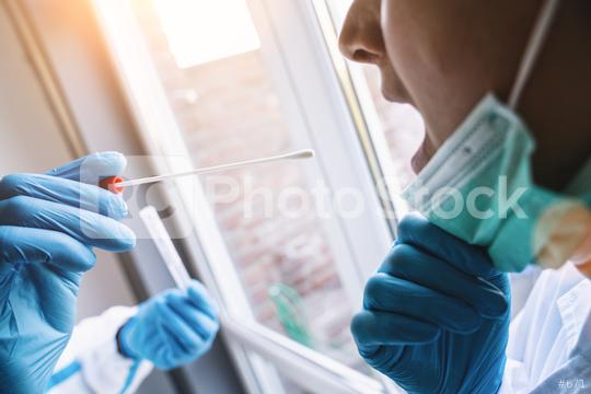 Medical in protective clothing takes COVID-19 swab test tube from mouth at Covid-19 test center during coronavirus epidemic. PCR DNA testing protocol process.  : Stock Photo or Stock Video Download rcfotostock photos, images and assets rcfotostock   RC-Photo-Stock.: