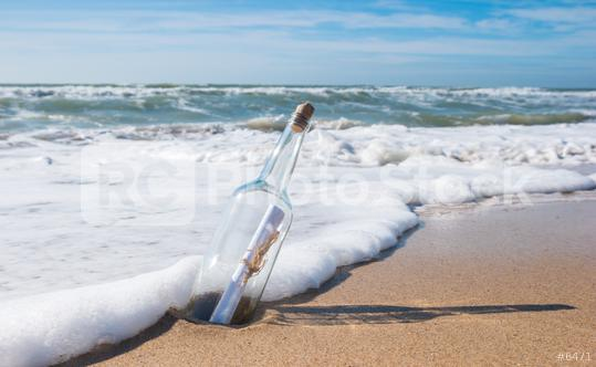 Message in a bottle on a lonely beach  : Stock Photo or Stock Video Download rcfotostock photos, images and assets rcfotostock | RC-Photo-Stock.: