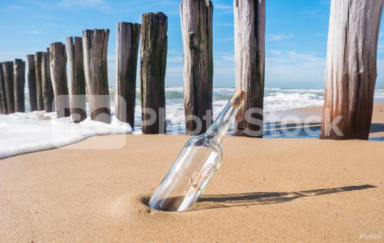 Message in a bottle on beach  : Stock Photo or Stock Video Download rcfotostock photos, images and assets rcfotostock   RC-Photo-Stock.: