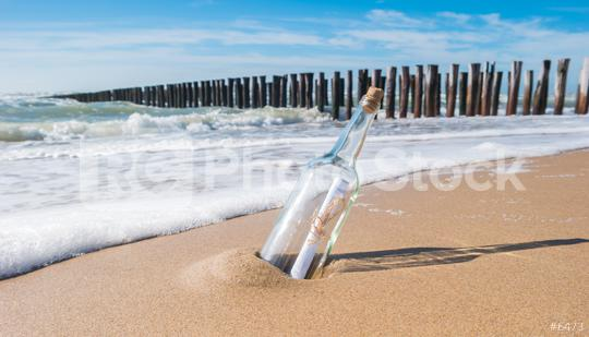 Message in a bottle on beach in Zeeland, Holland  : Stock Photo or Stock Video Download rcfotostock photos, images and assets rcfotostock | RC-Photo-Stock.: