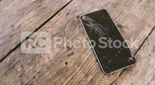 Modern mobile phone with broken screen on wooden background  : Stock Photo or Stock Video Download rcfotostock photos, images and assets rcfotostock | RC-Photo-Stock.: