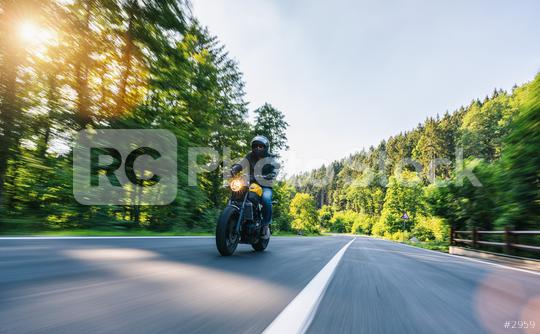 motorbike on the Alpine highway riding. having fun driving the empty road on a motorcycle tour journey. copyspace for your individual text.  : Stock Photo or Stock Video Download rcfotostock photos, images and assets rcfotostock | RC-Photo-Stock.: