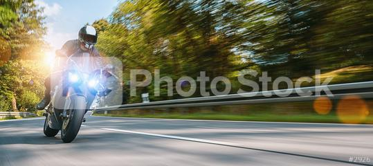 motorbike on the autumn road riding. having fun driving the empty highway on a motorcycle tour journey. copyspace for your individual text.  : Stock Photo or Stock Video Download rcfotostock photos, images and assets rcfotostock | RC-Photo-Stock.: