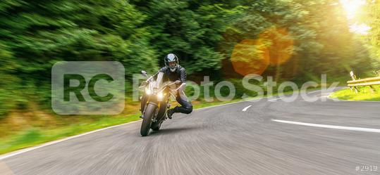 Motorbike on the forest road riding. having fun driving the empty road on a motorcycle tour journey. copyspace for your individual text.   : Stock Photo or Stock Video Download rcfotostock photos, images and assets rcfotostock | RC-Photo-Stock.: