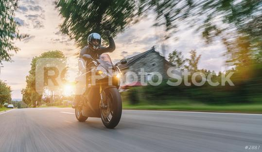 motorbike riding at a country city road. driving on road on a motorcycle tour. copyspace for your individual text.  : Stock Photo or Stock Video Download rcfotostock photos, images and assets rcfotostock | RC-Photo-Stock.: