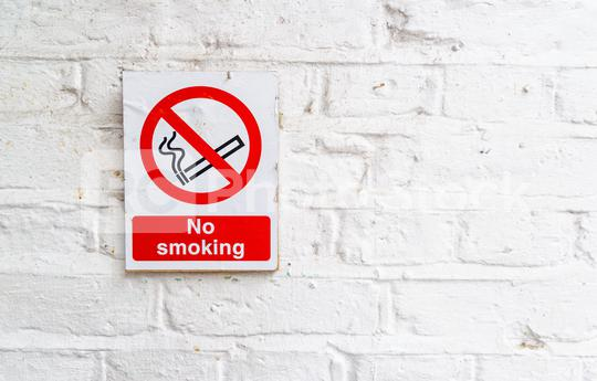 No smoking sign on a white brick wall, copy space for individual text  : Stock Photo or Stock Video Download rcfotostock photos, images and assets rcfotostock | RC-Photo-Stock.:
