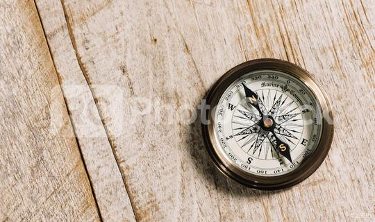 old compass on wood background concept for direction, travel, guidance or assistance  : Stock Photo or Stock Video Download rcfotostock photos, images and assets rcfotostock | RC-Photo-Stock.: