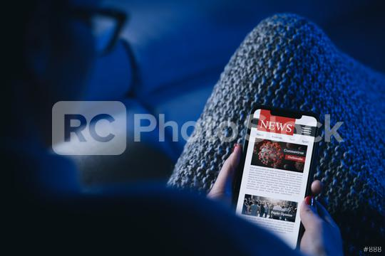 Online Corona news on a mobile phone. woman reading news or articles  about covid-19 in a smartphone screen application at the sofa. Hand holding smart device. Mockup website. COVID 19 nCov Outbreak.  : Stock Photo or Stock Video Download rcfotostock photos, images and assets rcfotostock   RC-Photo-Stock.: