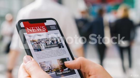 Online news on a mobile phone. Close up of businesswoman reading news or articles in a smartphone screen application. Hand holding smart device. Mockup website. Newspaper and portal on internet.  : Stock Photo or Stock Video Download rcfotostock photos, images and assets rcfotostock | RC-Photo-Stock.: