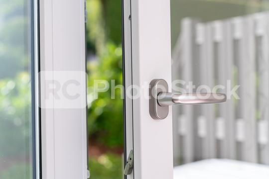 opened white plastic pvc window with garden view  : Stock Photo or Stock Video Download rcfotostock photos, images and assets rcfotostock | RC-Photo-Stock.: