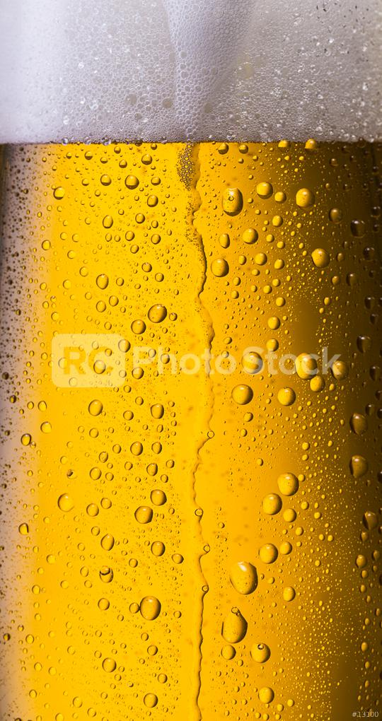 overflowing beer in a glass with dew drops  : Stock Photo or Stock Video Download rcfotostock photos, images and assets rcfotostock   RC-Photo-Stock.: