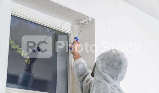 painter working with paint roller to paint the corner of a room window with white color. do it yourself concept image  : Stock Photo or Stock Video Download rcfotostock photos, images and assets rcfotostock | RC-Photo-Stock.: