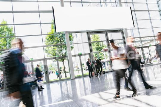 People on trade fair under advertising poster or banner ad   : Stock Photo or Stock Video Download rcfotostock photos, images and assets rcfotostock   RC-Photo-Stock.: