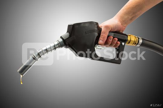 petrol pump nozzle with golden gas drops  : Stock Photo or Stock Video Download rcfotostock photos, images and assets rcfotostock | RC-Photo-Stock.: